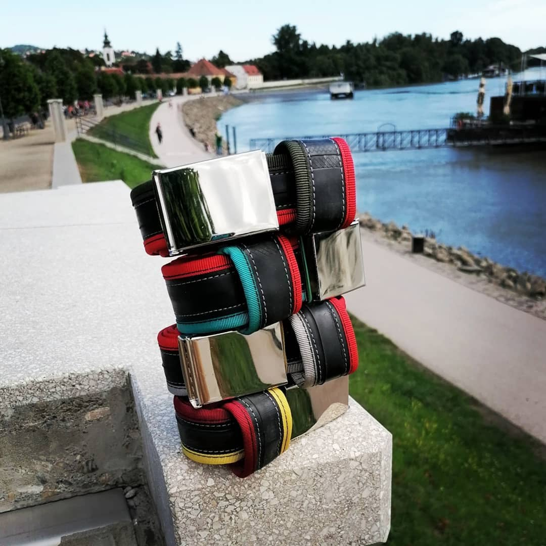 Recycled belts in various red combinations