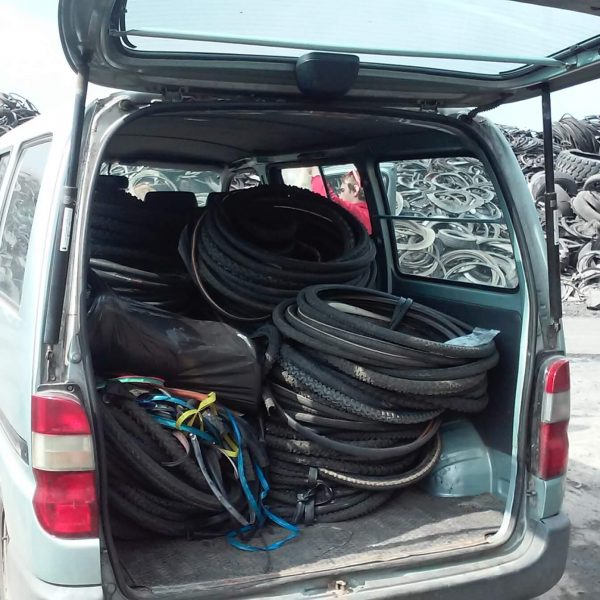 Felvarrom collecting wornout bicycle tires and tubes
