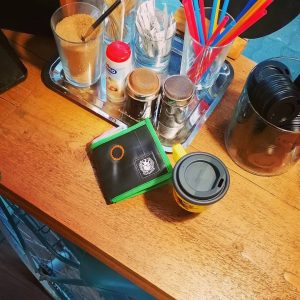 inner tube wallet in a coffe shop, green and black, recycled