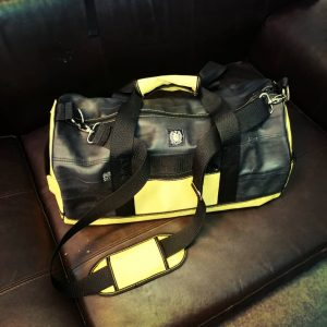 Yellow sport bag on couch, in use