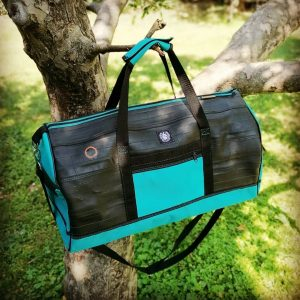 Turquoise blue sport bag from recycled bicycle tubes